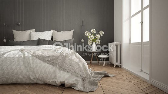 Scandinavian minimalist bedroom with big window and herringbone parquet, white and gray interior design, close-up : Stock Photo