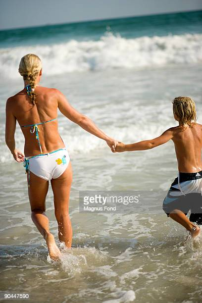 Scandinavian mother and son swimming Oman.