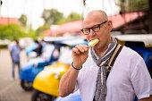Portrait Of Scandinavian Senior Tourist Man Having Vacation In Ayutthaya Former Capital City Of Siam Thailand