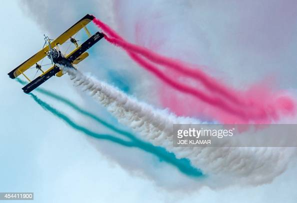 Scandinavian wingwalking duo 'Skycats' perform during the 'Catwalk' airshow on a Grumman164A aircraft at the Slovak International Air Fest SIAF 2014...