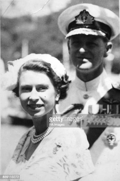 **Scanned lowres from contact** Queen Elizabeth II and the Duke of Edinburgh as they step ashore from a pontoon at Farm Cove Sydney to begin their...
