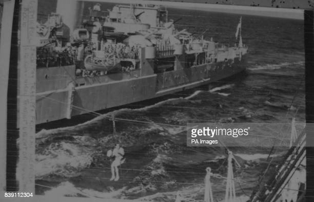 **Scanned lowres from contact** SurgeonLieutenant Commander Nicol being transferred by jackstay from the escort cruiser HMS Sheffield to the royal...
