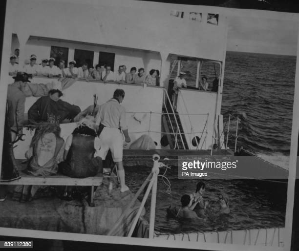 **Scanned lowres from contact** While the Queen watches the Duke of Edinburgh acts as assistant barber to Father Neptune who boarded the Royal tour...
