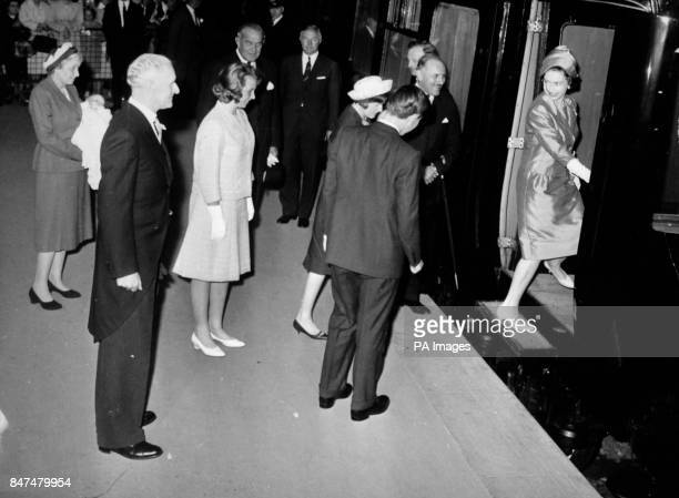 *Scanned lowres from print highres available on request* Queen Elizabeth II and other members of the Royal party board the train at Euston Station...