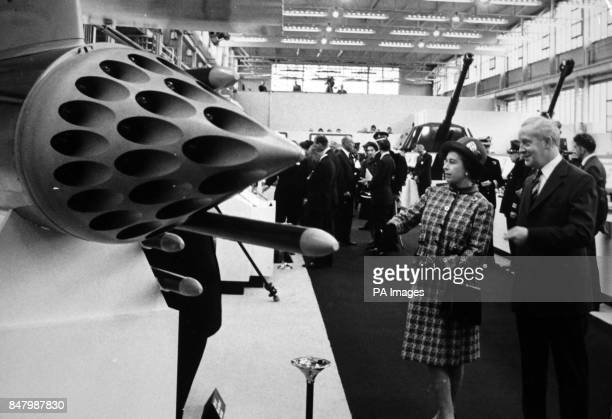 *Scanned lowres from print highres available on request* Queen Elizabeth II looking at an aircraft rocket launcher at Fort Halstead the design...
