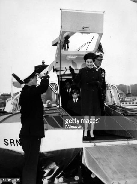 *Scanned lowres off print high res available on request* Queen Elizabeth II smiles and waves as followed by Admiral of the Fleet Earl Mountbatten and...