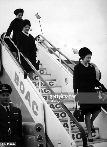 *Scanned lowres off print high res available on request* Queen Elizabeth II the Queen Mother and Princess Margaret leave a Comet aircraft of RAF Air...