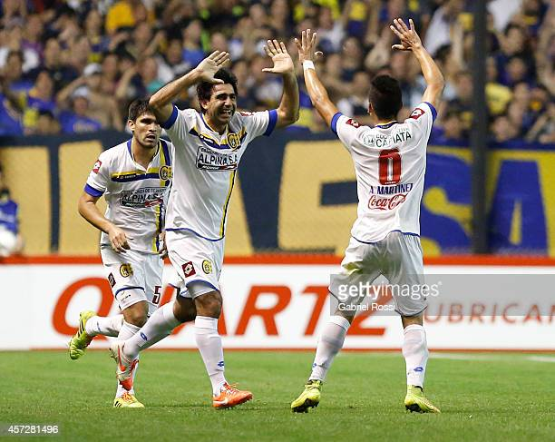 Óscar Ruiz and Ángel of Deportivo Capiata celebrate an own goal scored by Lisandro Magallán of Boca Juniors during a match between Boca Juniors and...