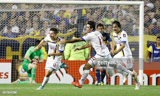 Óscar Ruiz of Deportivo Capiata celebrates with teammates an own goal scored by Lisandro Magallán of Boca Juniors during a match between Boca Juniors...