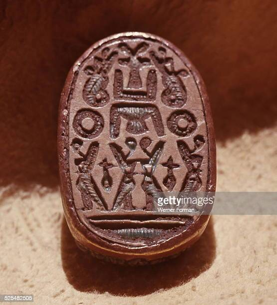 Scarab seal with hieroglyphics denoting deities amongst them the Horus falcons the two arms of the soul Ka and Nefer the symbol for goodness and...