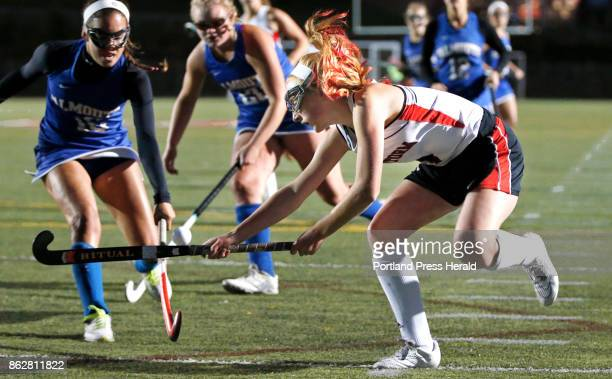 Scarborough forward Carrie Timpson crosses sticks with Falmouth defenders Juliana LaPorta left and Caitlin Bull on Tuesday at Scarbrough The Red...