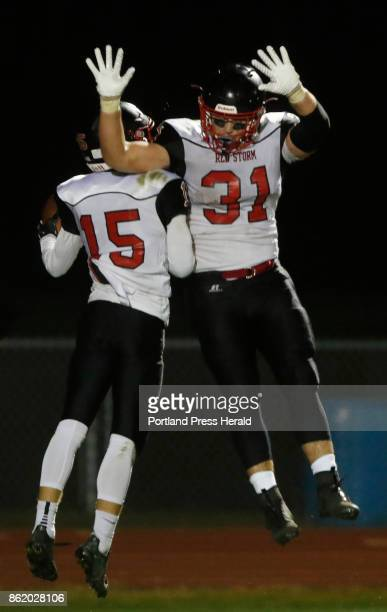 Scarborough wide receiver Cody Dudley and running back Owen Garrand celebrate Dudleys second quarter touchdown against Windham during varsity...