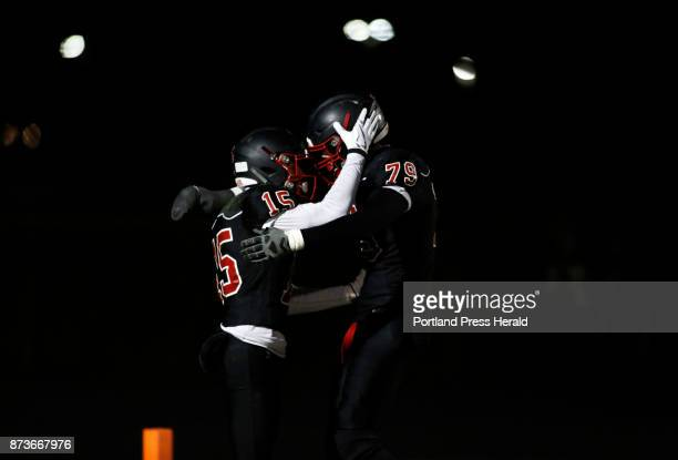 Scarborough's Cody Dudley left and Anthony Griffin celebrate a touchdown during the Class A South championship game against Thornton Academy in...