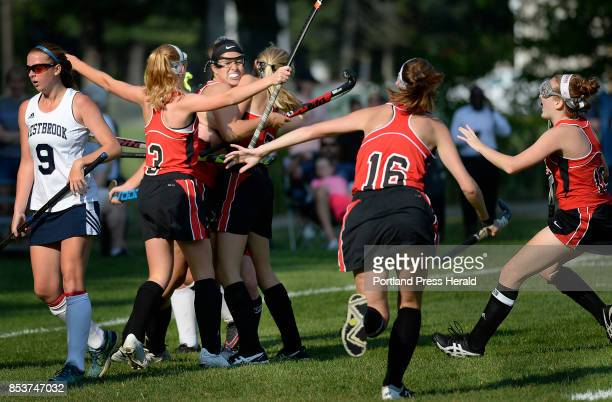 Scarborough's Lauren Topchick is swarmed by teammates after Topchick scored a first half goal that ended up being the game winner at Westbrook Friday...