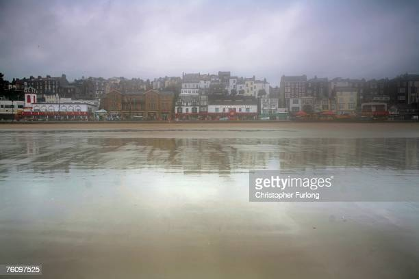 Scarborough's South beach lies empty of day trippers as rain clouds loom overhead on 14 August Scarborough England The traditional British seaside...
