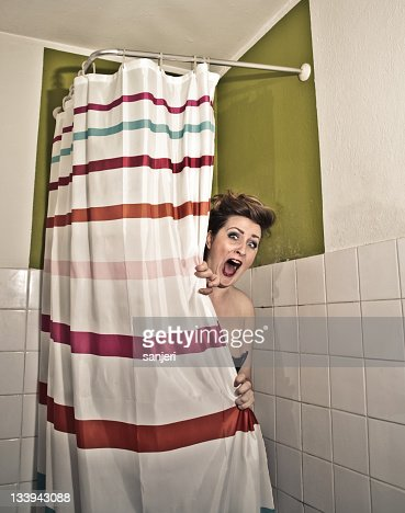 frightened woman in the shower