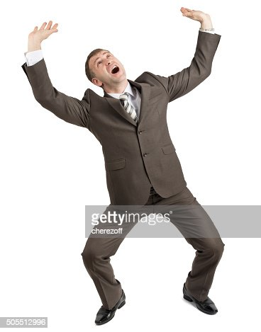 scared businessman looking up stock photo thinkstock