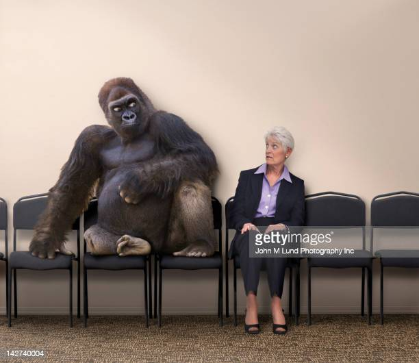 Scared Caucasian woman looking at gorilla