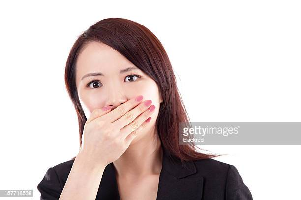 Scared Chinese Businesswoman Hand Covering Mouth on White Background