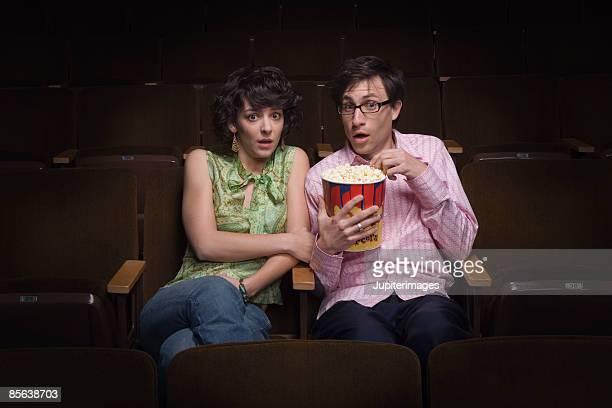 Scared couple in movie theatre