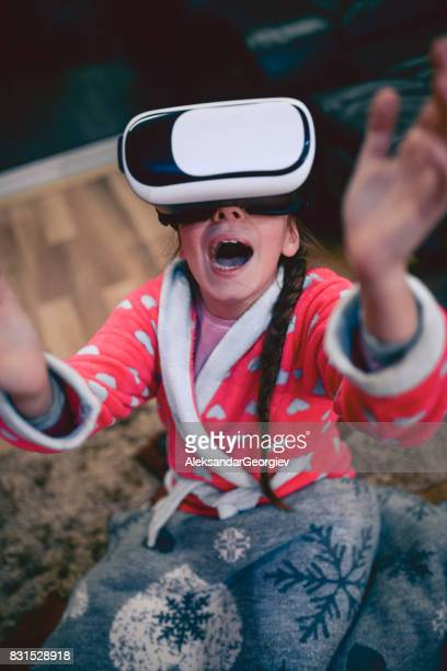 Scared Little Girl Screaming with Virtual Reality Simulator and Gesturing