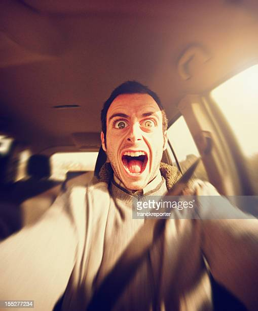 Scared man driving on the way