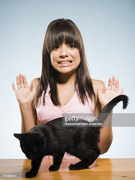 Scared woman with black kitten