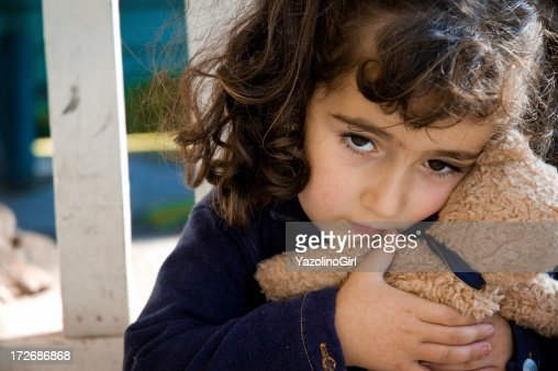 Scared/Sad Little Girl holding toy