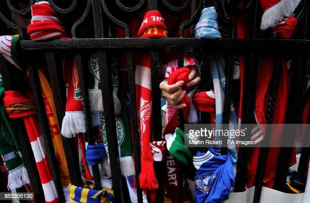 A scarf is tied to the Shankly Gates at Anfield before the Hillsborough 25th Anniversary Memorial Service