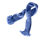 Scarf knitted handwork with fringe on white background. Colorful woolen scarf.