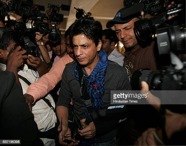 Scarf Kolkata Knight riders team owner Shahrukh Khan arrives for a meeting with IPL franchise owners in Mumbai at BCCI on Sunday at BCCI on Sunday