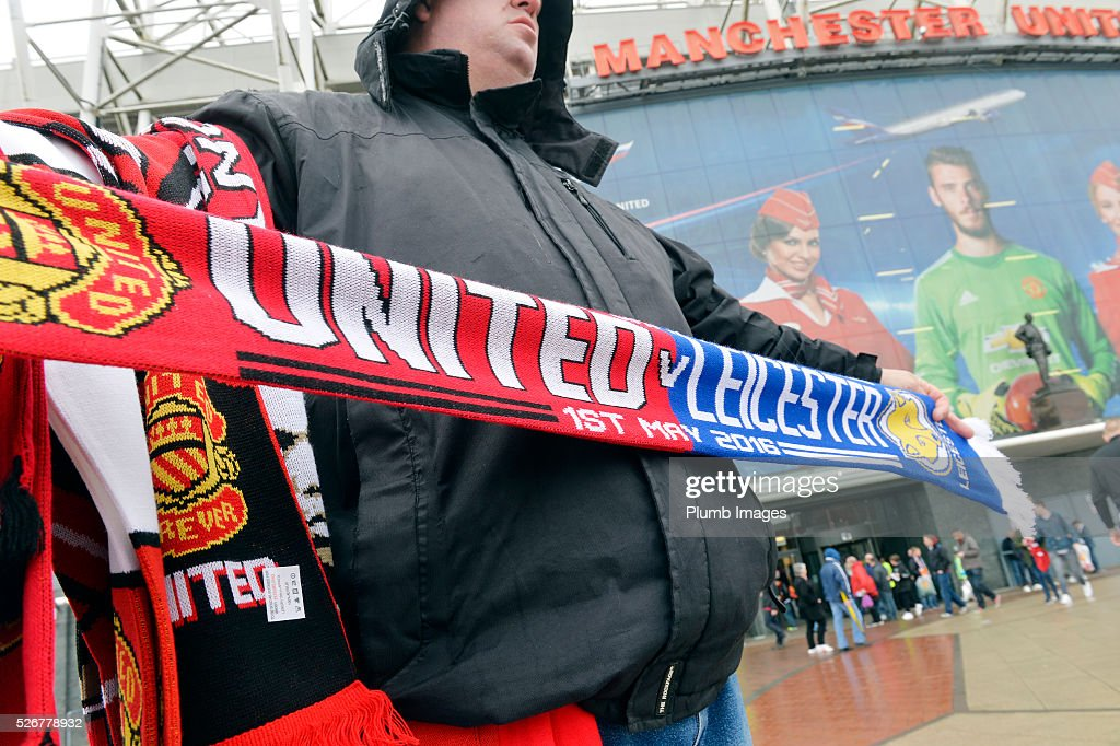 A scarf seller at Old Trafford ahead of the Premier League match between Manchester United and Leicester City at Old Trafford on May 01, 2016 in Manchester, United Kingdom.