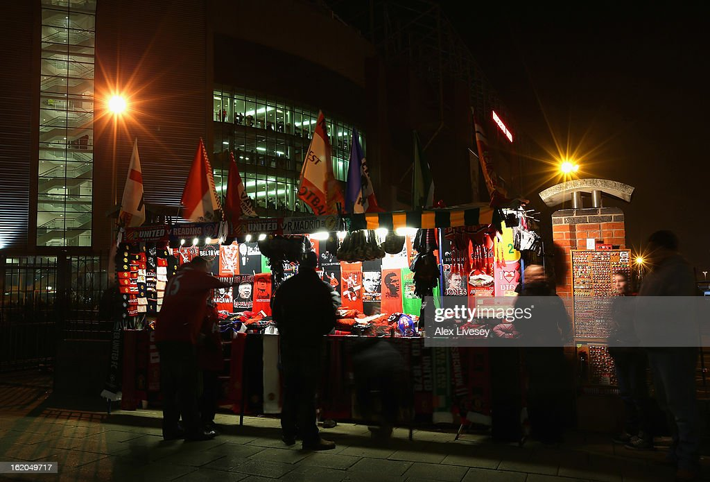 A scarf seller is seen outside Old Trafford the home ground of Manchester United prior to the FA Cup Fifth Round match between Manchester United and Reading at Old Trafford on February 18, 2013 in Manchester, England.