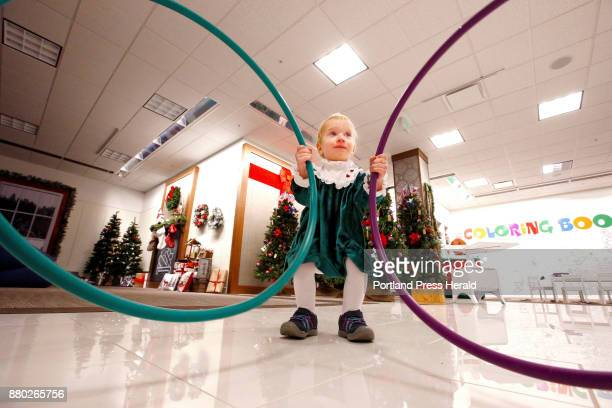 Scarlet Emmons of Windham plays with a pair of hulahoops at the Winter Wonderland on Wednesday at the Maine Mall With Black Friday losing its potency...