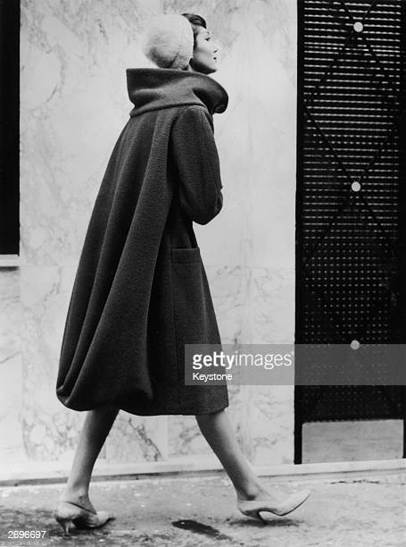 A scarlet wool coat with draped back from Pierre Cardin's first womanswear collection