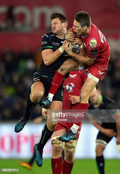 Scarlets fullback Liam Williams and Dan Biggar of the Ospreys compete for a high ball during the Guinness Pro 12 match between Ospreys and Scarlets...