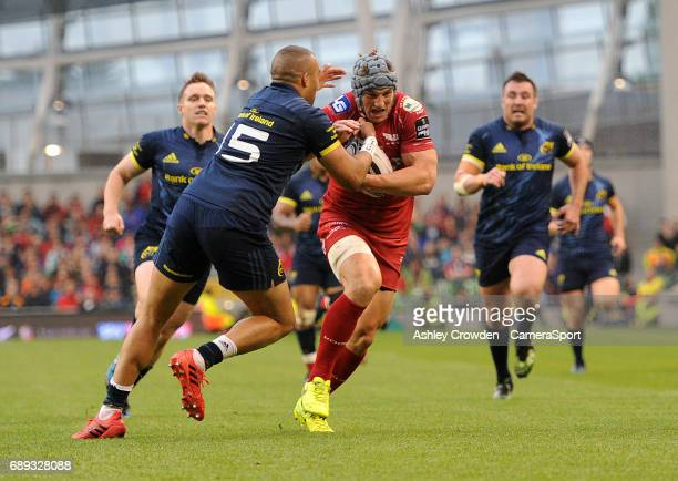Scarlets' Jonathan Davies evades the tackle of Munster's Simon Zebo during the Guinness PRO12 Final match between Munster and Scarlets at the Aviva...