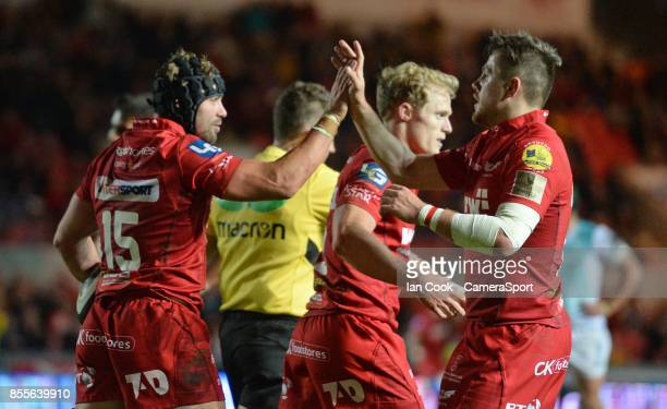 Scarlets' Leigh Halfpenny celebrates scoring his sides fourth try with teammate Steffan Evans during the Guinness Pro14 Round 5 match between...