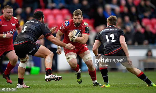 Scarlets number 8 John Barclay runs at the Saracens defence during the European Rugby Champions Cup match between Scarlets and Sarcens at Parc y...