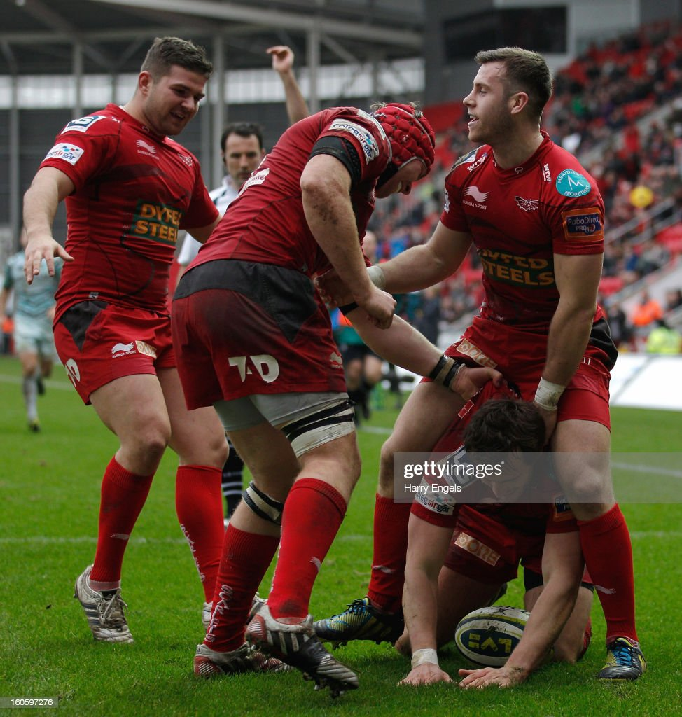 Scarlets players celebrate after Nic Reynolds scored a try during the LV= Cup match between Scarlets and Leicester Tigers at Parc y Scarlets on February 3, 2013 in Llanelli, Wales.
