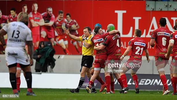 Scarlets players celebrate victory on the final whistle after the European Rugby Champions Cup match between Scarlets and RC Toulonnais at Parc Y...
