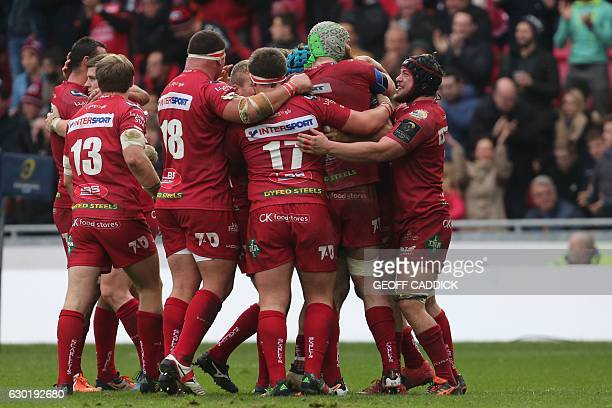 Scarlets players celebrates at the final whistle in the European Champions Cup rugby union pool 3 match between Scarlets and Toulon at Parc y...