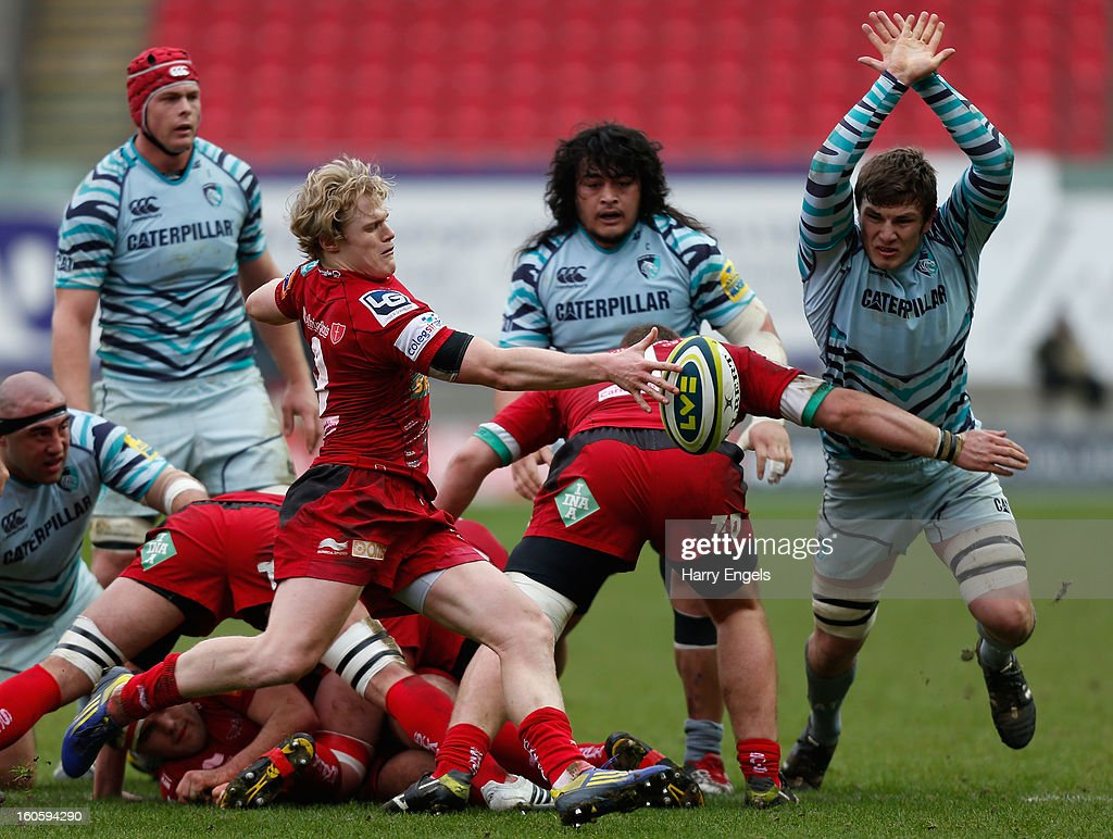 Scarlets scrum half <a gi-track='captionPersonalityLinkClicked' href=/galleries/search?phrase=Aled+Davies+-+Rugby+Union+Player&family=editorial&specificpeople=15320798 ng-click='$event.stopPropagation()'>Aled Davies</a> attempts a box kick during the LV= Cup match between Scarlets and Leicester Tigers at Parc y Scarlets on February 3, 2013 in Llanelli, Wales.