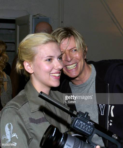 Scarlett Johansson and David Bowie seen backstage at BOWIE's first concert visit to Los Angeles in nearly seven years This is the second of four sold...