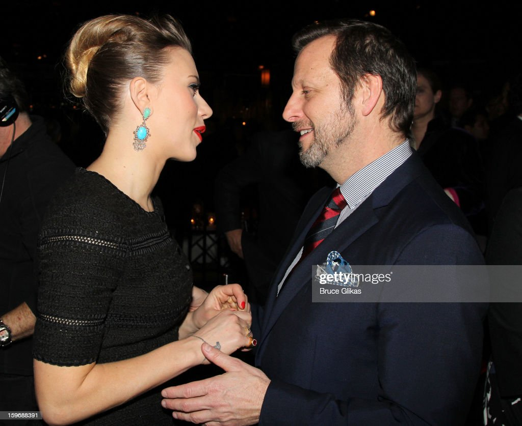 Scarlett Johansson and director Rob Ashford chat at the after party on opening night of 'Cat On A Hot Tin Roof' on Broadway at Chelsea Piers Lighthouse Pier 60 on January 17, 2013 in New York City.