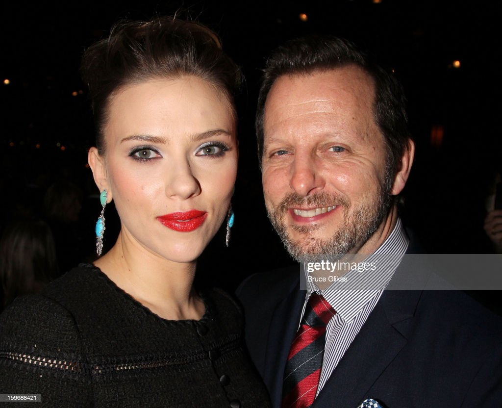Scarlett Johansson and director Rob Ashford pose at the after party on opening night of 'Cat On A Hot Tin Roof' on Broadway at Chelsea Piers Lighthouse Pier 60 on January 17, 2013 in New York City.
