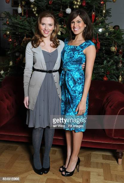 Scarlett Johansson and Eva Mendes attend a photocall to promote Frank Miller's latest film 'The Spirit' at the Mandarin Oriental in central London