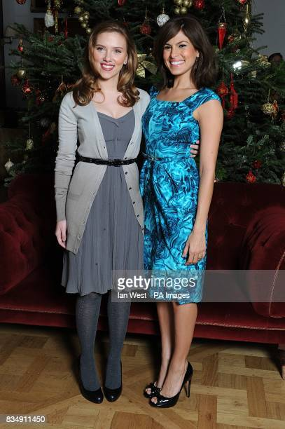 Scarlett Johansson and Eva Mendes attends a photocall to promote Frank Miller's latest film 'The Spirit' at the Mandarin Oriental in central London