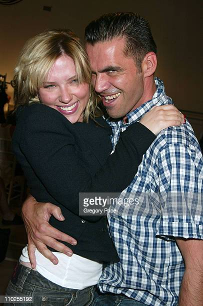 Scarlett Johansson and Roland Mouret during Olympus Fashion Week Spring 2006 Roland Mouret Sponsored by Motorola Front Row and Backstage at Skylight...