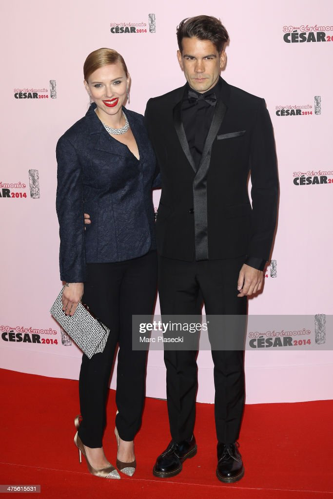 Scarlett Johansson and Romain Dauriac arrive for the 39th Cesar Film Awards 2014 at Theatre du Chatelet on February 28, 2014 in Paris, France.